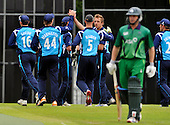 Cricket - ODI Summer Tri-Series - Scotland V Ireland at Grange CC - Edinburgh - Scotland celebrate dismissal of Ireland opener Will Porterfield - Picture by Donald MacLeod - 12.07.11 - 07702 319 738 - www.donald-macleod.com