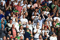 Swansea City fans cheer their team on during the Barclays Premier League match between Swansea City and Manchester City played at The Liberty Stadium, Swansea on 15th May 2016