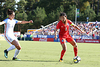 Cary, NC - Sunday October 22, 2017: Cho Sohyun and Carli Lloyd during an International friendly match between the Women's National teams of the United States (USA) and South Korea (KOR) at Sahlen's Stadium at WakeMed Soccer Park. The U.S. won the game 6-0.