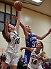 Morgan Wagner #20 of Whitman, left, and Lauren Romito #32 of Hauppauge battle for a rebound during a non-league tournament game at Whitman High School on Friday, Nov. 30, 2018. Whitman won by a score 51-46 in overtime.