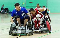 15 AUG 2011 - LEEDS, GBR - Canada's Mike Whitehead steers behind Great Britain's Ross Morrison during the wheelchair rugby exhibition match between the two teams .(PHOTO (C) NIGEL FARROW)