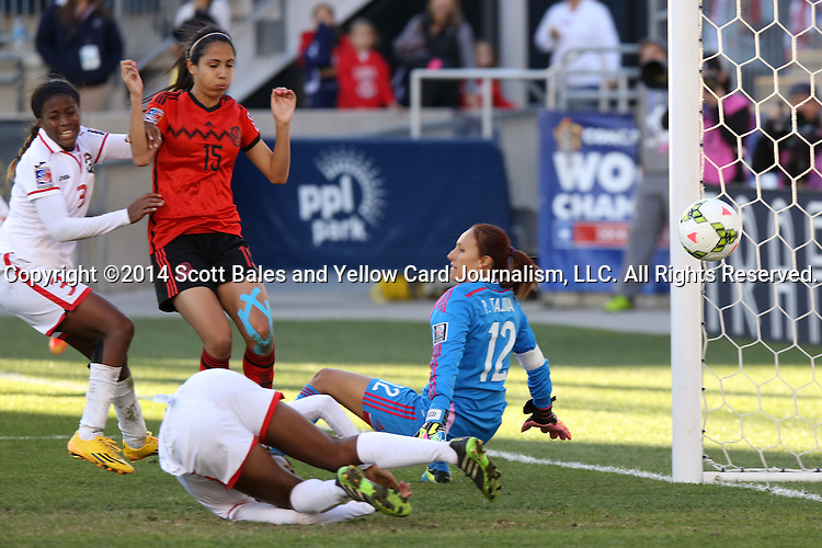 26 October 2014: Mariah Shade (TRI) (3) scores the go ahead goal past Pamela Tajonar (MEX) (12) and Christina Murillo (MEX) (15). The Trinidad & Tobago Women's National Team played the Mexico Women's National Team at PPL Park in Chester, Pennsylvania in the 2014 CONCACAF Women's Championship Third Place game. Mexico won the game 4-2 after extra time. With the win, Mexico qualified for next year's Women's World Cup in Canada and Trinidad & Tobago face playoff for spot against Ecuador.