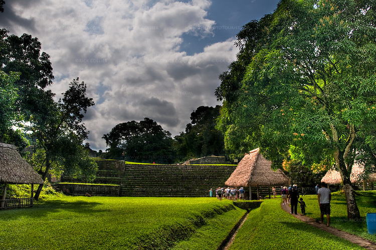 High Dynamic Range image of the lawn and stairs up to the royal precinct at Quirigua Archaeological Park in central Guatemala.  Quirigua is one of the smaller Mayan sites, but also one of the most notable due to the artistry of its stelae, which Mayan rulers during the Classic Period commissioned to commemorate important political and dynastic events. Nowadays, the temples and palaces lie in ruins around the pleasant green park that once was the great plaza of Quirigua and archaeologists are only now piecing them back together.  Quirigua features a total of 22 carved stelae and zoomorphs (large boulders carved to represent animals and covered with figures and glyphs), which are among the finest examples of classic Mayan stone carvings.