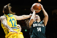Melbourne, 15 August 2015 - Chevannah PAALVAST of New Zealand is fouled by Belinda SNELL of Australia in game one of the 2015 FIBA Oceania Championships in women's basketball between the Australian Opals and the New Zealand Tall Ferns at Rod Laver Arena in Melbourne, Australia. Aus def NZ 61-41. (Photo Sydney Low / sydlow.com)