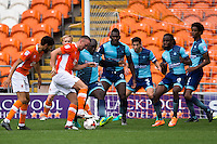 Adebayo Akinfenwa of Wycombe Wanderers looks to scramble the ball away during the Sky Bet League 2 match between Blackpool and Wycombe Wanderers at Bloomfield Road, Blackpool, England on 20 August 2016. Photo by James Williamson / PRiME Media Images.
