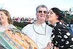 Chairman Jim Corcoran gets a kiss from Best Dressed Lady Competition Judge Triona McCarthy after being presented with a birthday cake from the committee at the Bellewstown Races...Picture Jenny Matthews/Newsfile.ie