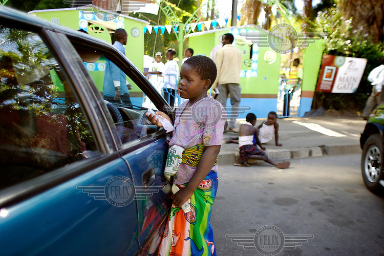 "Street child begging. Under the government initative Murambatsvina (Operation Restore Order), many homes and places of work in slum areas were destroyed. Since then there has been a marked increase in the number of children living on the streets of Harare. Murambatsvina, also translated as ""clean up the filth"", continues. Street children are picked up and dumped miles out of town to discourage them from being on the street."
