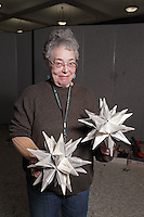 Details of tree and decoration process, Rosalind Joyce with modular origami decorations ready for the tree.