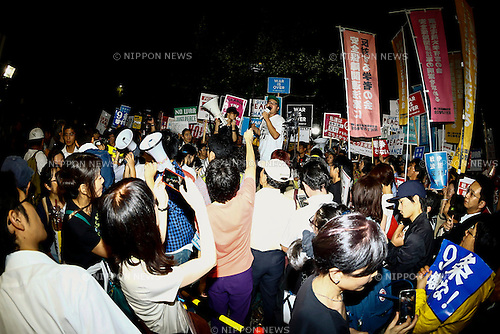 Members of the Students Emergency Action for Liberal Democracy (SEALDs) and followers hold placards against proposed new security legislation in front of the National Parliament on September 11, 2015, Tokyo, Japan. According to the organizers more than 10,000 students, young people, academics, workers and pensioners, joined the demonstration to express their opposition to the Abe government. Prime Minister Shinzo Abe  is preparing to formalize the ''constitutional reinterpretation''  through parliament to permit Japan Self Defense Forces to fight on overseas soil. (Photo by Rodrigo Reyes Marin/AFLO)