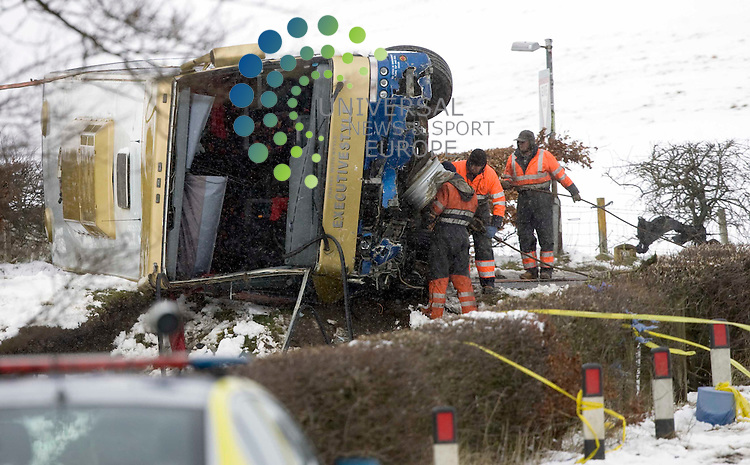 Recovery crews pull the bus out of the river after four children were seriously injured when a school coach on a trip to Alton Towers crashed on the A73 at Wiston, near Biggar, South Lanarkshire. .31 March 2010 Picture: Universal News And Sport (Europe)...