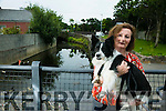 Geraldine Nolan with Millie  the Dog concerned about the lack of life preserves at the Brewery Road bridge.