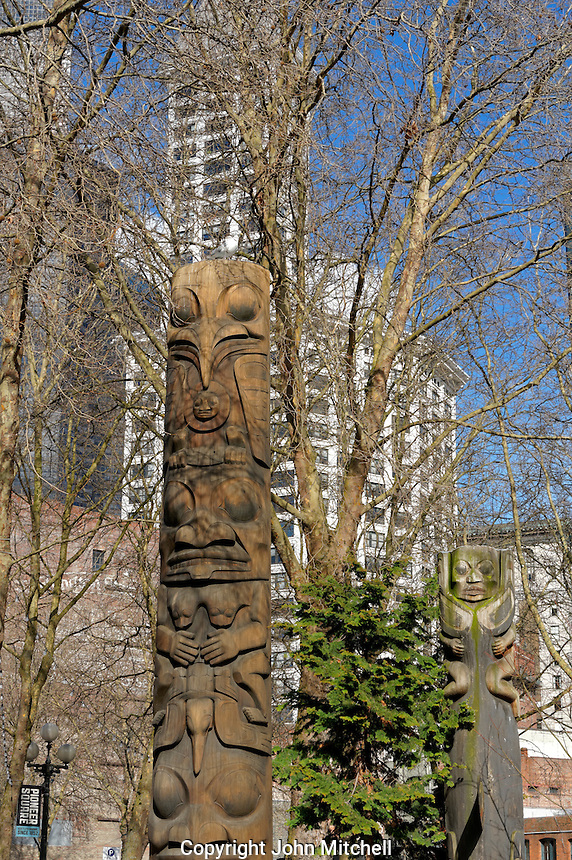 Native American totem poles in Occidental Square Park in the Pioneer Square district of Seattle, Washington, USA