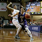 SIOUX FALLS, SD: Mack Johnson #3 from the University of Sioux Falls gets a step past KJ Davis #14 from Southwest Minnesota State in the first half of their NSIC Tournament game Sunday at the Sanford Pentagon (Photo by Dave Eggen/Inertia)