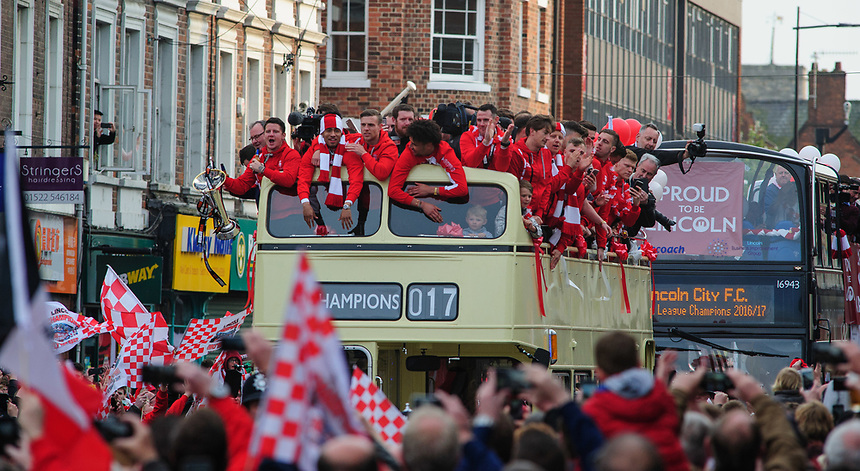 Lincoln City players travel on an open top bus through Lincoln's High Street as they celebrate winning the Vanarama National League<br /> <br /> Photographer Andrew Vaughan/CameraSport<br /> <br /> Vanarama National League - Lincoln City - Champions Parade - Tuesday May 2nd 2017 - Lincoln<br /> <br /> World Copyright &copy; 2017 CameraSport. All rights reserved. 43 Linden Ave. Countesthorpe. Leicester. England. LE8 5PG - Tel: +44 (0) 116 277 4147 - admin@camerasport.com - www.camerasport.com