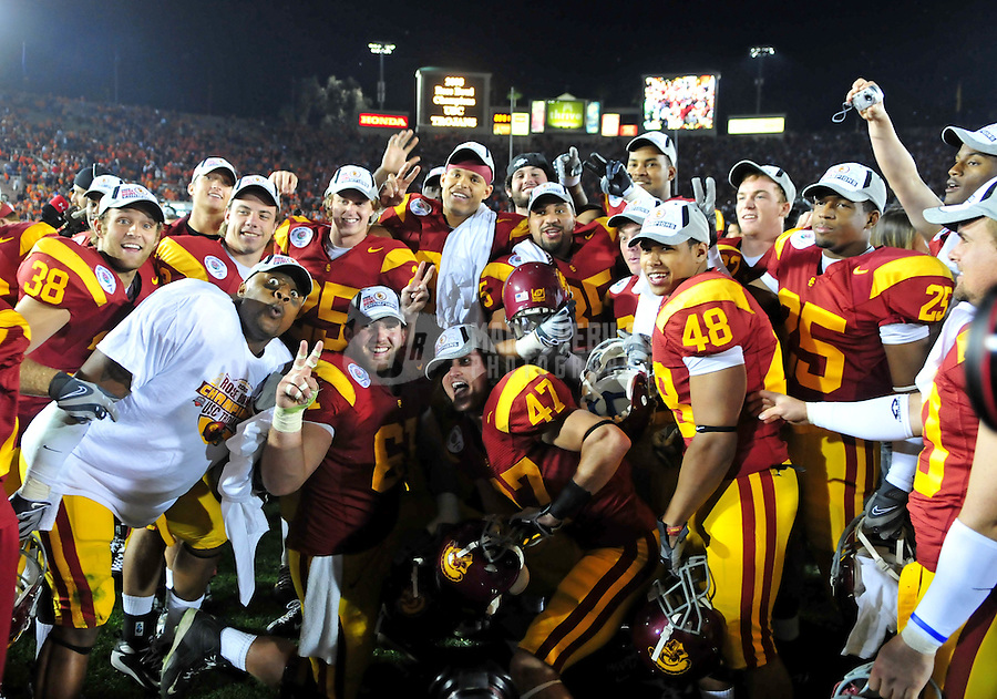 Jan 1, 2008; Pasadena, CA, USA; Southern California Trojans players celebrate after defeating the Illinois Fighting Illini during the Rose Bowl game at the Rose Bowl in Pasadena, California. The Trojans defeated the Fighting Illini 49-17. Mandatory Credit: Mark J. Rebilas-US PRESSWIRE