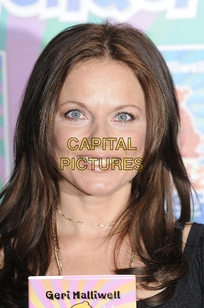 """GERI HALLIWELL.""""Ugenia Lavender"""" booksigning at Waterstone's Children's Department,.Harrods, Knightsbridge, London UK.27th September 2008.book signing portrait headshot brunette dyed brown hair .CAP/DH.©David Hitchens/Capital Pictures"""