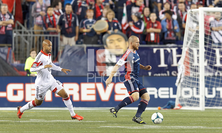 New England Revolution substitute midfielder Chad Barrett (9) dribbles as D.C. United substitute midfielder Kyle Porter (19) closes. In a Major League Soccer (MLS) match, the New England Revolution (blue) defeated D.C. United (white), 2-1, at Gillette Stadium on September 21, 2013.