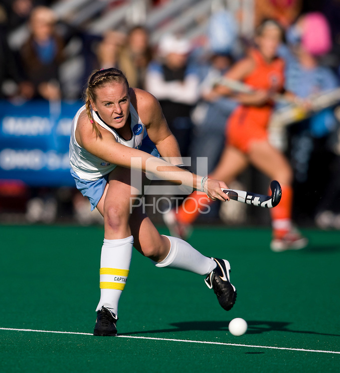 Elizabeth Drazdowski (18) of UNC follows through on a pass during the NCAA Field Hockey Championship semfinals in College Park, MD.  North Carolina defeated Virginia, 4-3, in overtime.