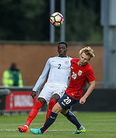 Dominic Iorfa (Wolverhampton Wanderers) of England hits the ball upfield via a Norwegian players face during the International EURO U21 QUALIFYING - GROUP 9 match between England U21 and Norway U21 at the Weston Homes Community Stadium, Colchester, England on 6 September 2016. Photo by Andy Rowland / PRiME Media Images.