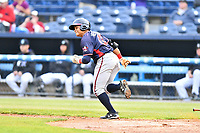 Rome Braves right fielder Randy Ventura (11) runs to first base during a game against the Asheville Tourists at McCormick Field on May 22, 2017 in Asheville, North Carolina. The Braves defeated the Tourists 7-3. (Tony Farlow/Four Seam Images)