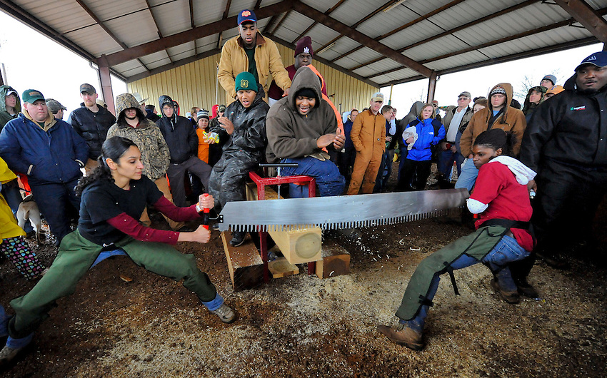 Alabama A&M women's crosscut saw team of Jeanette Williams and Christina Harper compete as Alabama A&M hosts the Southern Forestry Conclave 2009 at the Winfred Thomas Agricultural Farm in Hazel Green Saturday .  Bob Gathany / The Huntsville Times