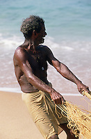 A fisherman hauling on a net, near Kovalam.
