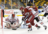 Chris Rawlings (NU - 37), Eric Kroshus (Harvard - 10) - The Northeastern University Huskies defeated the Harvard University Crimson 4-1 (EN) on Monday, February 8, 2010, at the TD Garden in Boston, Massachusetts, in the 2010 Beanpot consolation game.