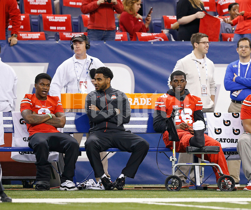 Ohio State Buckeyes running back Dontre Wilson (2), Ohio State Buckeyes quarterback Braxton Miller (5) and Ohio State Buckeyes quarterback J.T. Barrett (16) sit on on the bench before their game against Wisconsin Badgers in the 2014 Big Ten Football Championship Game at Lucas Oil Stadium in Indianapolis, Ind. on December 6, 2014.  (Dispatch photo by Kyle Robertson)
