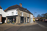 A parade of local village shops in historic buildings, Saxmundham, Suffolk, England