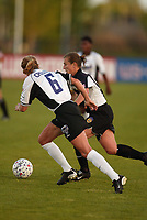 Brandi Chastain of the San Jose CyberRays and Tiffeny Milbrett of the New York Power race for the ball during their game at Mitchell Athletic Complex on May 5. The CyberRays won 1-0.