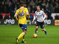 Bolton Wanderers' Andrew Taylor competing with Leeds United's Jamie Shackleton<br /> <br /> Photographer Andrew Kearns/CameraSport<br /> <br /> The EFL Sky Bet Championship - Bolton Wanderers v Leeds United - Saturday 15th December 2018 - University of Bolton Stadium - Bolton<br /> <br /> World Copyright &copy; 2018 CameraSport. All rights reserved. 43 Linden Ave. Countesthorpe. Leicester. England. LE8 5PG - Tel: +44 (0) 116 277 4147 - admin@camerasport.com - www.camerasport.com