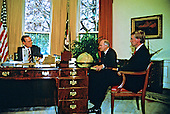 United States President George H.W. Bush meets senior advisors during a briefing on the upcoming Malta Summit with Soviet President Mikhail Gorbachev (not pictured) in the Oval Office of the White House in Washington, D.C. on November 28, 1889.  From left to right: President Bush; National Security Advisor Brent Scowcroft; and U.S. Vice President Dan Quayle..Credit: Arnie Sachs / CNP
