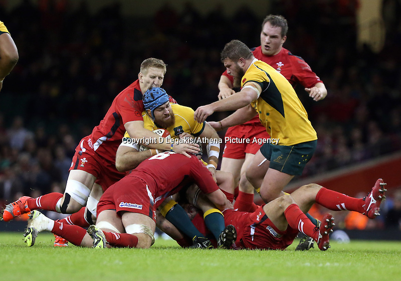 Pictured: of Australia (with ball) is brought down by Dan Lydiate of Wales (6) Saturday 08 November 2014<br /> Re: Dove Men Series rugby, Wales v Australia at the Millennium Stadium, Cardiff, south Wales, UK.