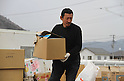 "March 30, 2011, Ishinomaki, Miyagi, Japan - More than two weeks after the tsunami, volunteer groups look to contribute to the relief effort. Terao Kanako drove his truck full of supplies all the way from Kitakyushu. ""The Japanese people will never lose to an earthquake."" He shouts from on top of his truck. (Photo by Wesley Cheek/AFLO) [3682]."