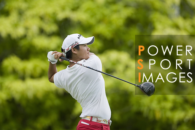 SINGAPORE - MARCH 05:  Yani Tseng of Taiwan plays her tee shot on the par four 6th hole during the first round of HSBC Women's Champions at the Tanah Merah Country Club on March 5, 2009 in Singapore. Photo by Victor Fraile / The Power of Sport Images
