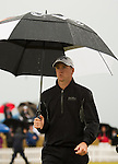 Alex Noren of Sweden is called off the range as a further tropical downpour arrives to delay the completion of the second round  of the Barclays Scottish Open, played over the links at Castle Stuart, Inverness, Scotland from 7th to 10th July 2011:  Picture Stuart Adams /www.golffile.ie 9th July 2011
