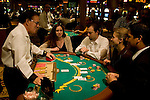 Blackjack table in Las Vegas, Nevada, Caesars Palace and Casino, gaming, gambling, chips, blackjack, betting croupier, blackjack players, model released, blackjack table, cards, NV, Las Vegas, Photo nv238-17909..Copyright: Lee Foster, www.fostertravel.com, 510-549-2202,lee@fostertravel.com