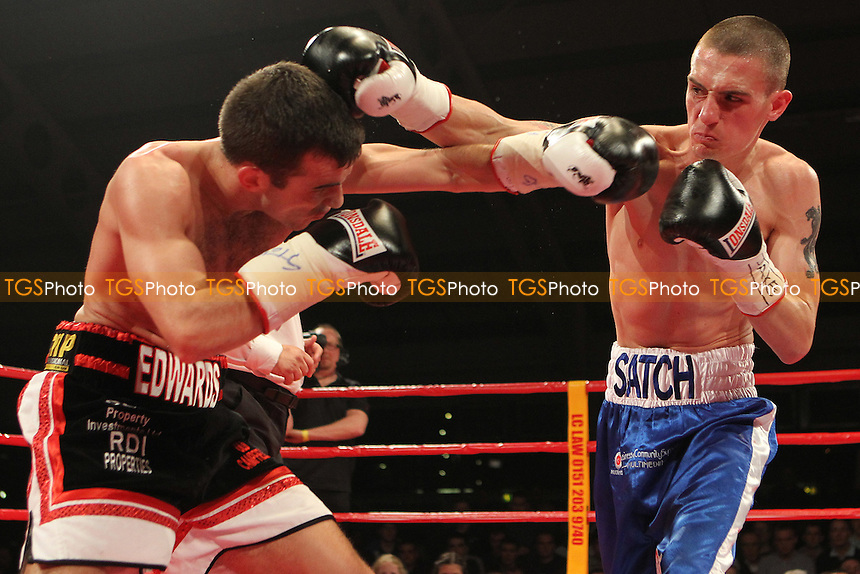 17c32f732f Kevin Satchell (blue shorts) vs Paul Edwards in a boxing contest for the  vacant