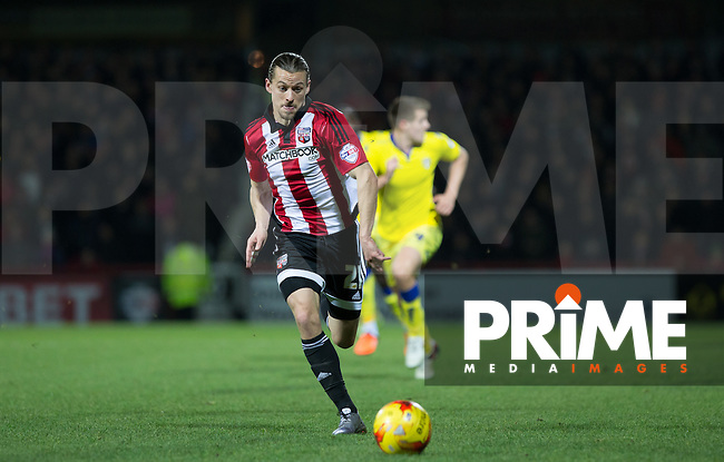 Lasse Vibe of Brentford chases down the ball during the Sky Bet Championship match between Brentford and Leeds United at Griffin Park, London, England on 26 January 2016. Photo by Andy Rowland / PRiME Media Images.