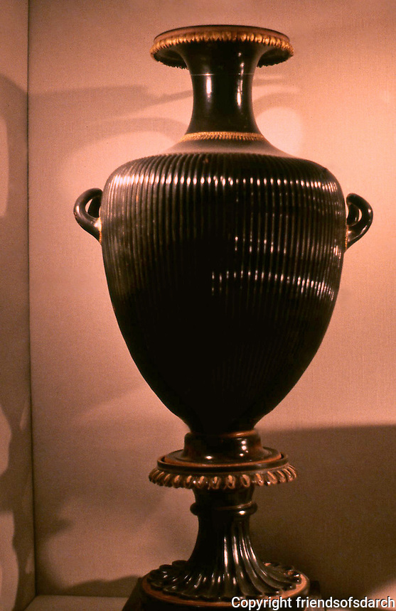 Greek Vases:  Black Hydria with stand. South Italian, 340 B.C.  Fluted body imitates similar vessels made of bronze. Terracotta, like preceding.  Getty Museum.