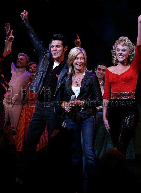 Olivia Newton-John is headed back to Rydell High to promote Breast Cancer Awareness after the Curtain Call for GREASE at the Brooks Atkinsoon Yheatre in New York City. <br />October 7, 2008<br />( pictured: Olivia Newton John, Derek Keeling, Ashley Spencer)