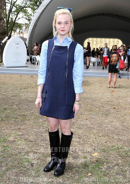Elle Fanning arriving at the Unique catwalk show as part of London Fashion Week SS13, Top Shop Venue, Bedford Square, London. 16/09/2012 Picture by: Henry Harris / Featureflash