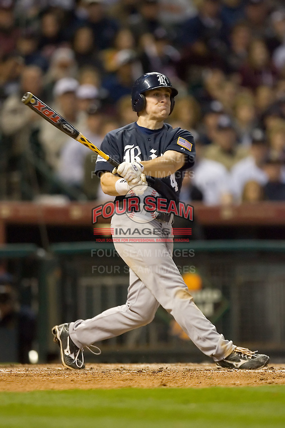 Chad Mozingo #4 of the Rice Owls follows through on his swing versus the Texas A&M Aggies in the 2009 Houston College Classic at Minute Maid Park February 28, 2009 in Houston, TX.  The Owls defeated the Aggies 2-0. (Photo by Brian Westerholt / Four Seam Images)