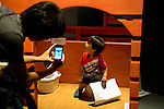 """A visitor takes a picture of his son sitting on toilet at the Toilet!? Human Waste & Earth's Future exposition on August 1, 2014 in Tokyo, Japan. The Toilet!? Human Waste & Earth's Future is an exposition to listen the toilet's voice and explore what is the """"happy toilet"""" for each human being on the earth at National Museum of Emerging Science and Innovation in Tokyo from July 2 to October 5. The toilet is related not only to our daily life but also to the global environment. The exposition consist of eight areas where you can learn toilet problems for each generation and in the world. (Photo by Rodrigo Reyes Marin/AFLO)"""