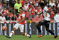 BOGOTÁ -COLOMBIA, 02-04-2017. Anderson Plata (Izq.) jugador de Santa Fe disputa el balón con Didier Moreno (Der.) jugador del Independiente Medellin durante el encuentro entre Independiente Santa Fe y Independiente Medellin por la fecha 11 de la Liga Aguila I 2017 jugado en el estadio Nemesio Camacho El Campin de la ciudad de Bogota. / Anderson Plata (L) player of Santa Fe struggles for the ball with Didier Moreno (R) player of Independiente Medellin during match between Independiente Santa Fe and Independiente Medellin for the date 11 of the Aguila League I 2017 played at the Nemesio Camacho El Campin Stadium in Bogota city. Photo: VizzorImage/ Gabriel Aponte / Staff