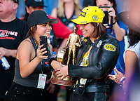 Nov 17, 2019; Pomona, CA, USA; NHRA pro stock motorcycle rider Jianna Salinas celebrates with sister Jacqueline Salinas after winning the Auto Club Finals at Auto Club Raceway at Pomona. Mandatory Credit: Mark J. Rebilas-USA TODAY Sports