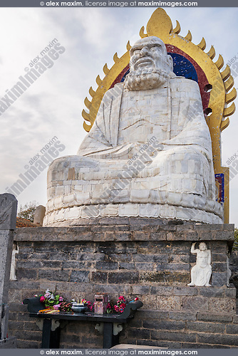 Bodhidharma statue on top of the mountain Song in DengFeng, Zhengzhou, Henan Province, China 2014 Image © MaximImages, License at https://www.maximimages.com