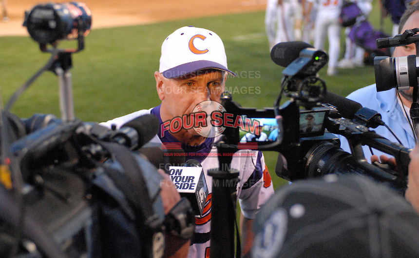 Head coach Jack Leggett (7) of the Clemson Tigers talks to the media after the Tigers defeated the Elon College Phoenix on March 21, 2012, at Fluor Field at the West End in Greenville, South Carolina. Clemson's 4-2 win gave Leggett his 1,200th career win. (Tom Priddy/Four Seam Images)