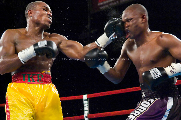 "Ike ""Bazooka"" Quartey (l)  lands flush on Vernon Forest during their 10 rounds Junior Middleweight Fight at MSG in New York City on 08.05.06. Forest won by Unanimous Decision."