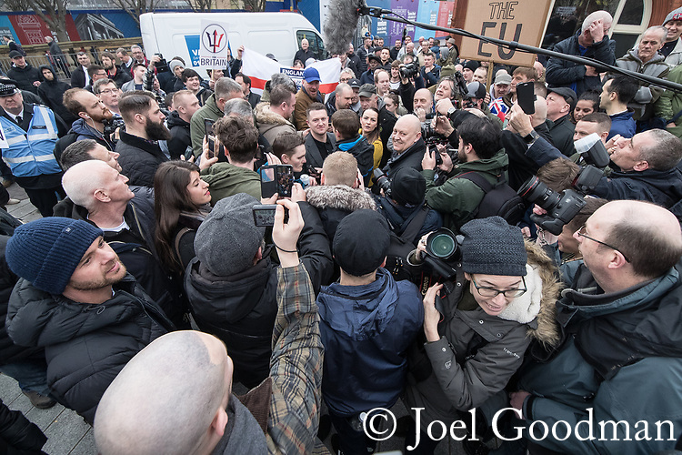 © Joel Goodman - 07973 332324. 24/03/2018. Birmingham, UK. Former EDL leader TOMMY ROBINSON is seen acting as a journalist for Rebel Media at a Football Lads Alliance demonstration against Islam and extremism in Birmingham City Centre . Offshoot group, The True Democratic Football Lads Alliance, also hold a separate demonstration . Photo credit : Joel Goodman